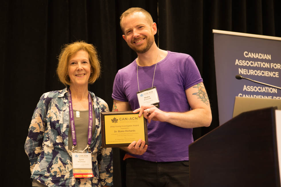Blake Richards receives the 2019 CAN Young Investigator Award, from Lynn Raymond, Chair of the nominations committee
