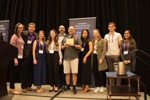 The Ottawa SfN Chapter, winners of the 2019 CAN outreach and advocacy award, with CAN President Jaideep Bains.